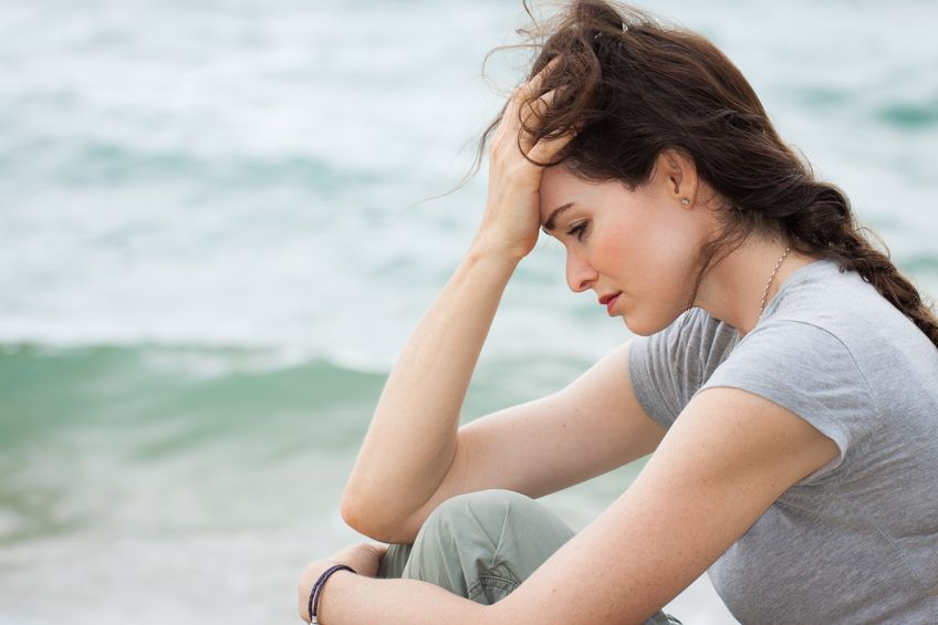 18206088 - close-up of a sad and depressed woman deep in thought outdoors