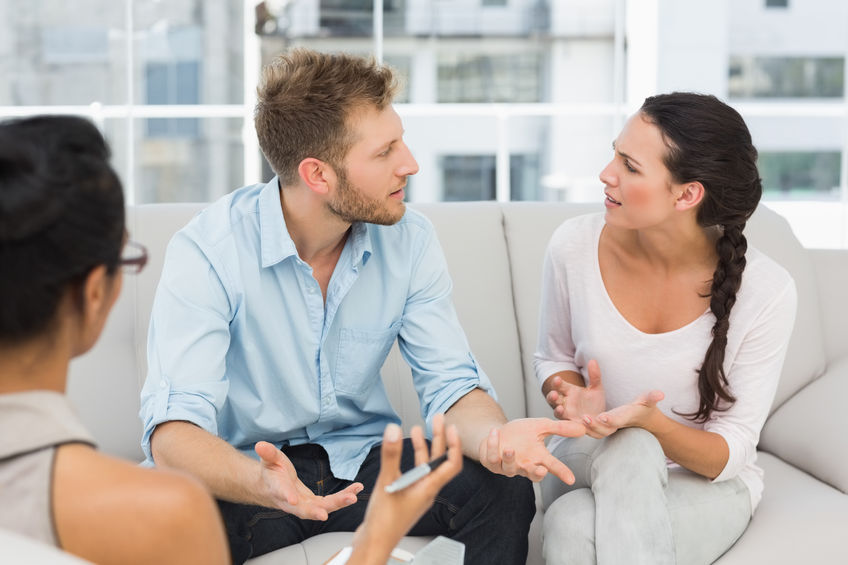 28408932 - unhappy couple arguing at therapy session in therapists office