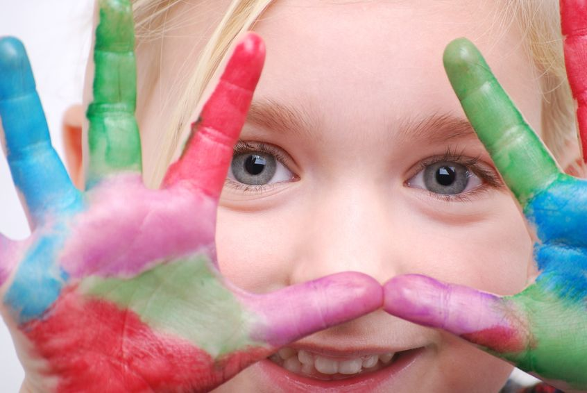 8602931 - little girl with paint on hands-focus on eyes